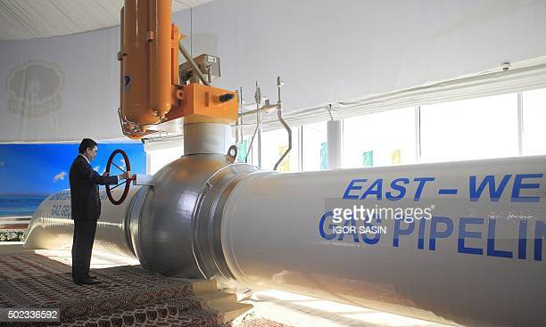 Turkmenistan's President Gurbanguly Berdymukhamedov takes part in the opening ceremony of the EastWest pipeline at the Belek compressor station some...