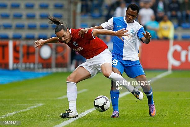 LR Turku's Davi Rancan and Genk's Samuel Yeboah fight for the ball during the return leg match between Belgian club KRC Genk and Finnish club FC...