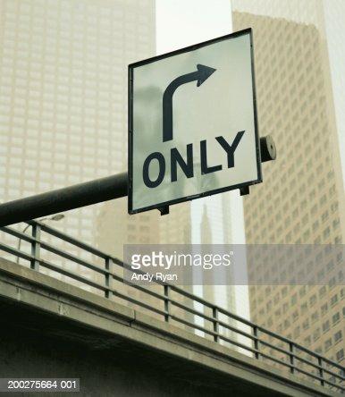 Turn sign on urban overpass : Stock Photo