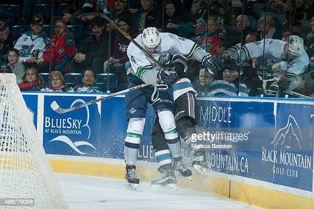 Turner Ottenbreit of Seattle Thunderbirds checks a player of the Kelowna Rockets into the boards during first period on November 25 2015 at Prospera...