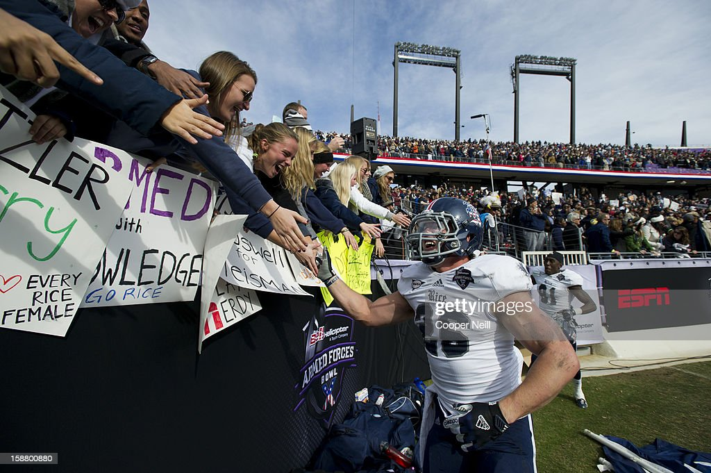 Turner Petersen #26 of the Rice Owls celebrates with fans after defeating the Air Force Falcons on December 29, 2012 in the Bell Helicopter Armed Forces Bowl at Amon G. Carter Stadium in Fort Worth, Texas.