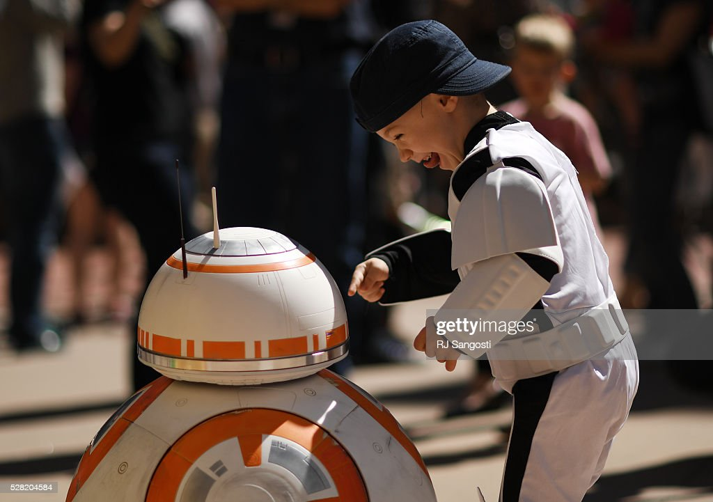 Turner Russell, 4, is all smiles when meeting BB-8 outside the Denver Art Museum, May 04, 2016. The museum held a May the 4th Be With You event to kick off ticket sales for the upcoming exhibition, Star Wars and the Power of Costume, opening at the DAM in November.