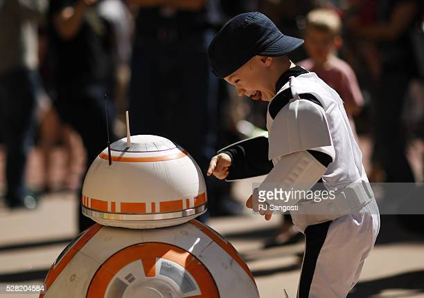 Turner Russell is all smiles when meeting BB8 outside the Denver Art Museum May 04 2016 The museum held a May the 4th Be With You event to kick off...