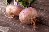 Fresh turnips on a wooden tabletop.