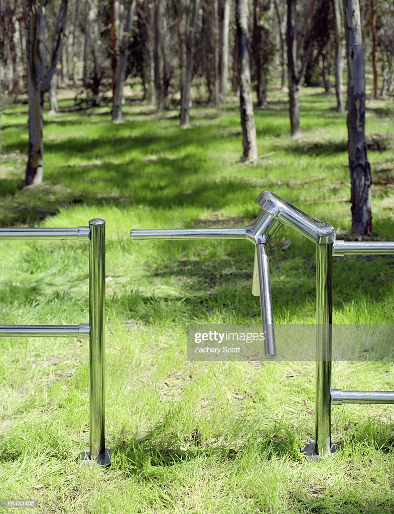 Turnstile installed in forest : Stock Photo