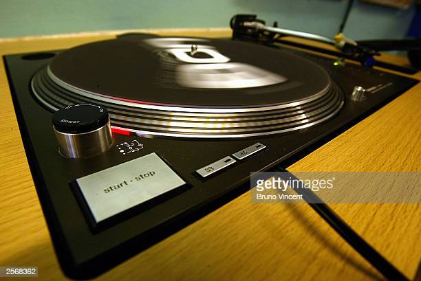 A turntable spins in a record shop October 7 2003 in London Falling sales of CD's and the imminent relaunch of online music swapshop 'Napster' have...