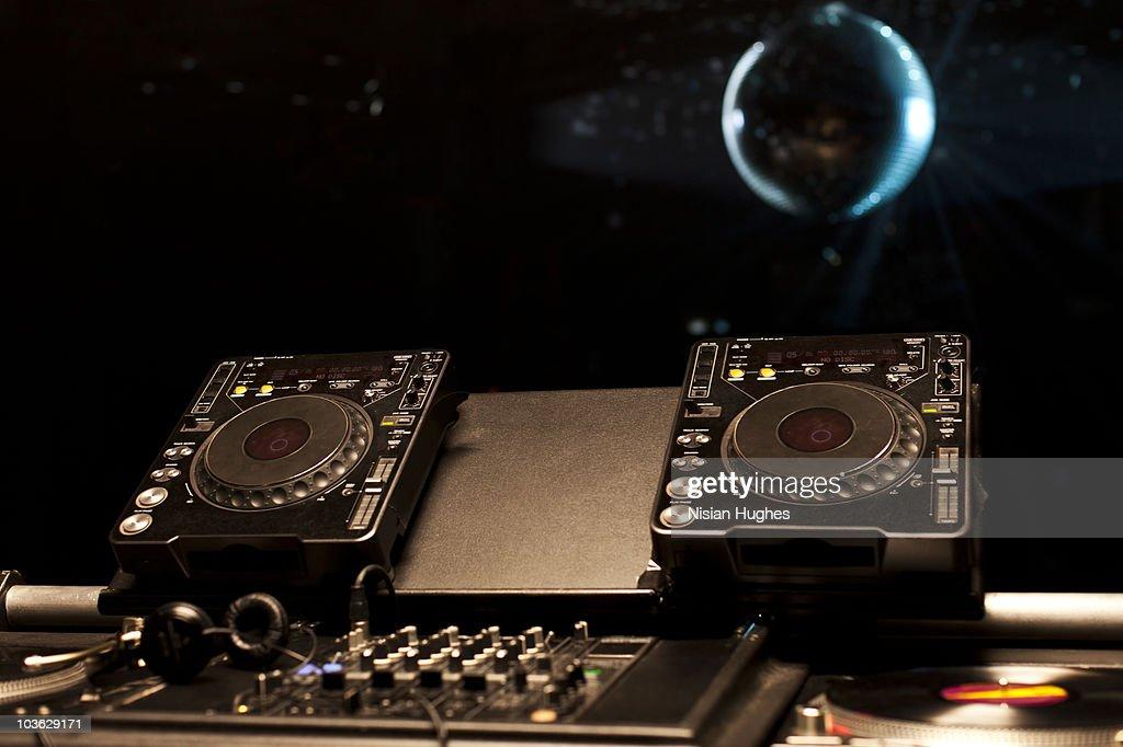 DJ turntables in a nightclub : Stock Photo