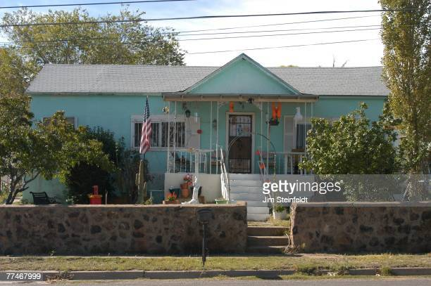 turquoise house with halloween decorations and american flag in silver city new mexico on october 21