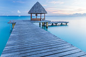 Ponton and little house on turquoise lagoon, vision of a dream