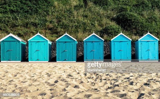 Turquoise painted wooden beach huts in Bournemouth : Stock Photo