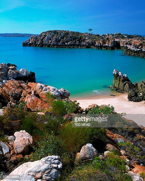 turquoise sea off island beach with rock outcrops, buccaneer archipelago, wa