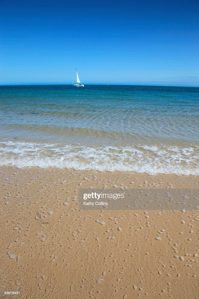 Turquoise sea with yacht sandy beach gentle waves