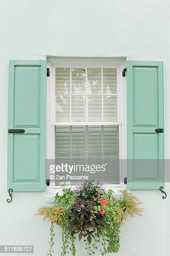 turquoise shutters and flower box on window