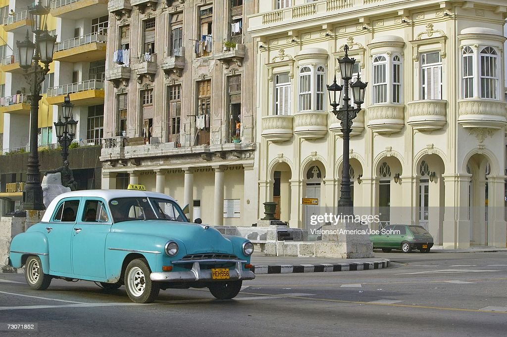 'Turquoise taxi driving the streets of Old Havana, Cuba' : Stock Photo
