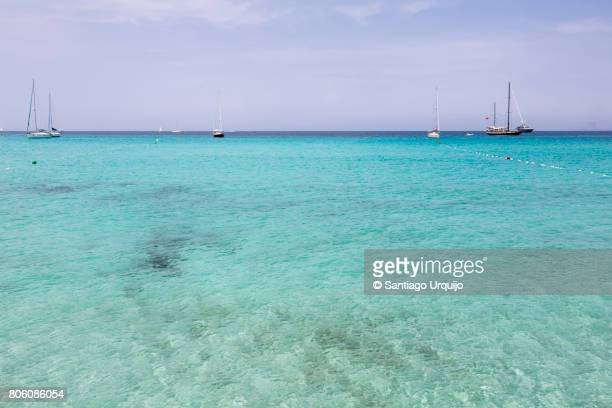Turquoise waters at Ses Illetes beach