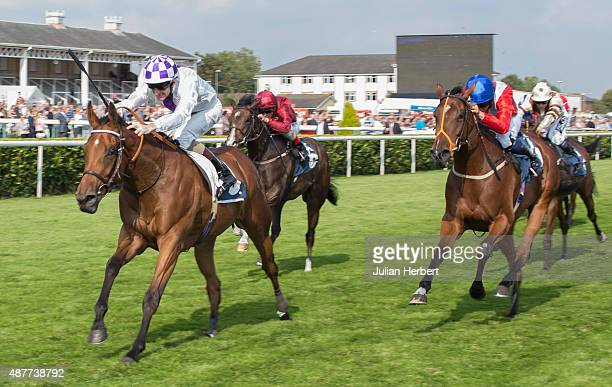 Turret Rocks ridden by Kevin Manning leads the field home to win The 1stsecuritysoloutionscouk May Hill Stakes Race run at Doncaster Racecourse on...