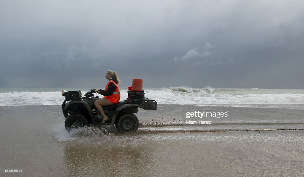 Turtle patrol ATV drives across flooded beach at Sunrise Blvd caused by high tides and wind driven waves on Ft Lauderdale Beach Florida Friday...