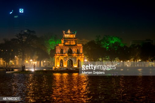 Turtle Tower lit golden at night