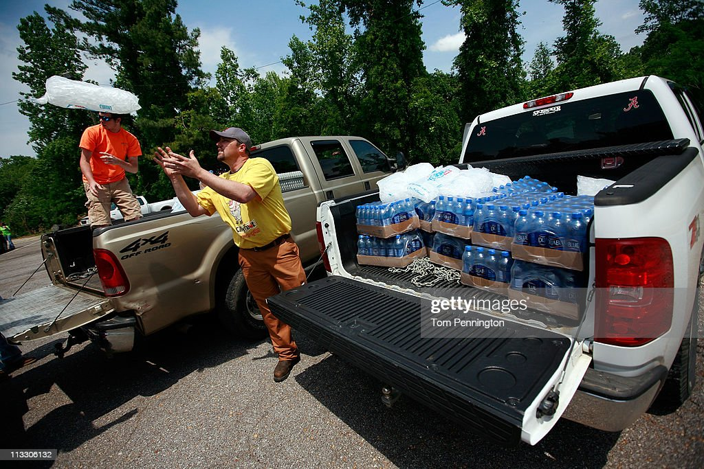 Tuscaloosa Moose Lodge members (R-L) Jason Hunter and Ross Sanders load ice and bottled water to be distributed to area residents on May 1, 2011 in Tuscaloosa, Alabama. Alabama, the hardest-hit of six states, is reported to have been battered with at least an EF-4 rated tornado with the death toll across the South rising to over 300 as a result of the storms.