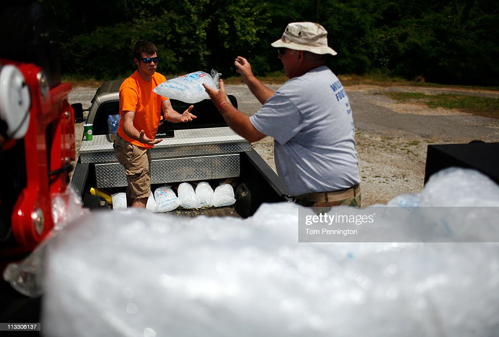 Tuscaloosa Moose Lodge members (R-L) J.C. Hunter and Ross Sanders load ice and bottled water to be distributed to area residents on May 1, 2011 in Tuscaloosa, Alabama. Alabama, the hardest-hit of six states, is reported to have been battered with at least an EF-4 rated tornado with the death toll across the South rising to over 300 as a result of the storms.