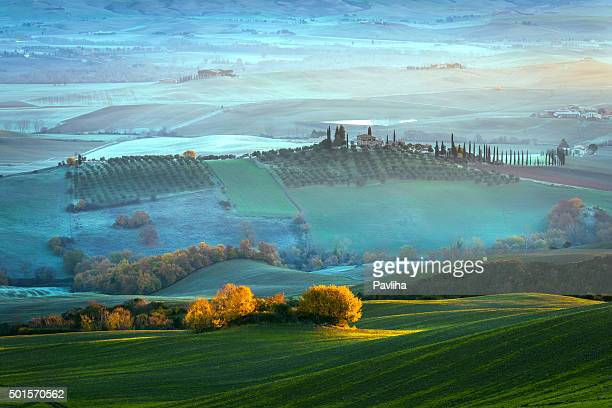 Tuscany farmhouse,morning, frost, winter, mist,Italy.