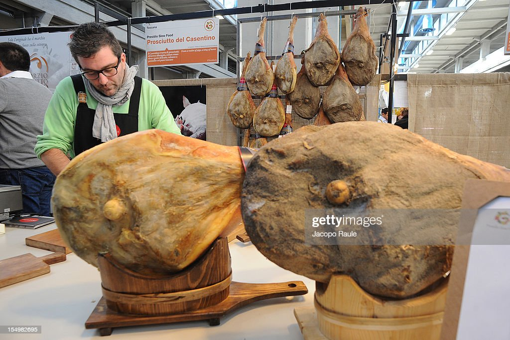 Tuscany hams on display on a stand at the Slow Food's Salone del Gusto and Terra Madre 2012 on October 29, 2012 in Turin, Italy.