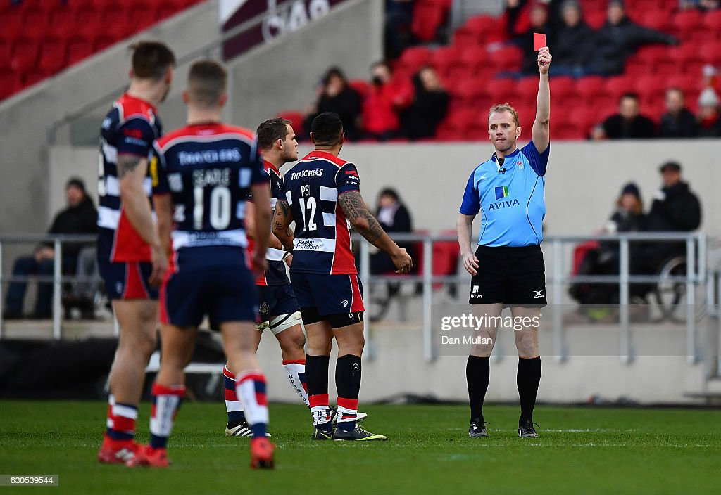 Tusi Pisi of Bristol Rugby is shown a red card by Referee, Wayne Barnes for tackling Jamie Shillcock of Worcester Warriors in the air during the Aviva Premiership match between Bristol Rugby and Worcester Warriors at Ashton Gate on December 26, 2016 in Bristol, England.
