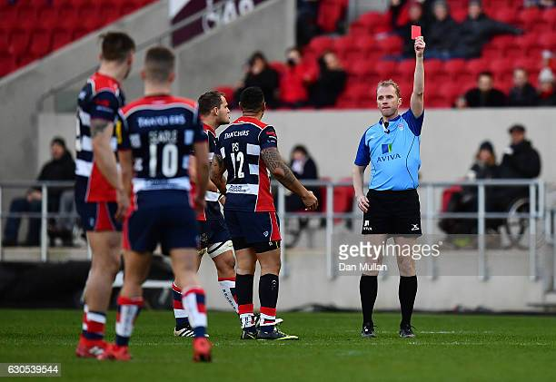 Tusi Pisi of Bristol Rugby is shown a red card by Referee Wayne Barnes for tackling Jamie Shillcock of Worcester Warriors in the air during the Aviva...
