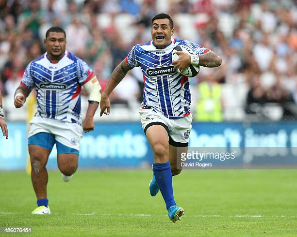 Tusi Pisi of Samoa runs with the ball during the Rugby Union match between the Barbarians and Samoa at the Olympic Stadium on August 29 2015 in...