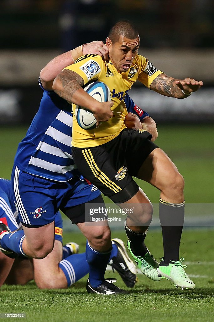 Tusi Pisi of the Hurricanes is tackled during the round 11 Super Rugby match between the Hurricanes and the Stormers at FMG Stadium on April 26, 2013 in Palmerston North, New Zealand.