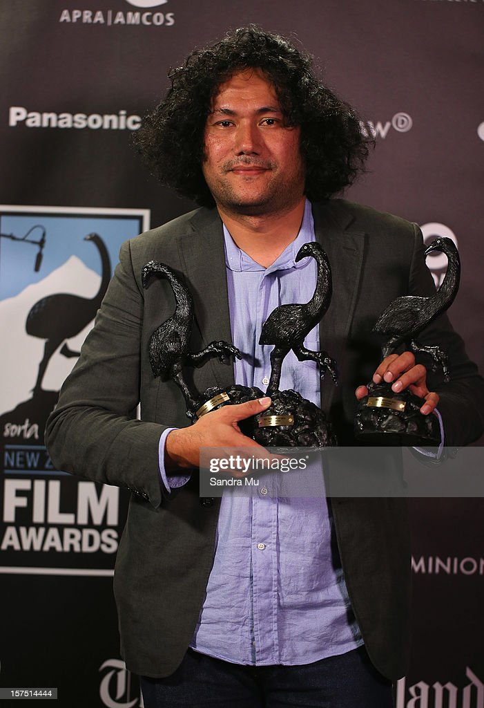 Tusi Tamasese, Director of Orator poses with his awards for Best Film, Best Director and Best Screenplay during the MOA 'Unofficial' New Zealand Film Awards at The Civic on December 4, 2012 in Auckland, New Zealand.