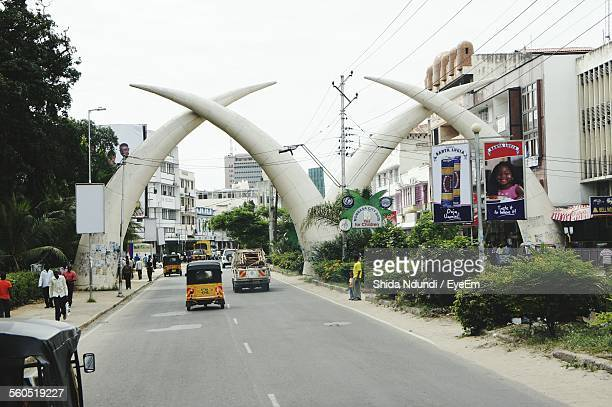 Tusk Arches Over City Street