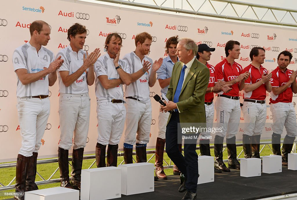 Tusk CEO Charlie Mayhew (6L) speaks as (L to R) Team Audi Ultra members Prince William, Duke of Cambridge, Luke Tomlinson, Mark Tomlinson, Prince Harry and William Melville-Smith and Team Audi Quattro members Freddie Mannix, Robert Jornayvaz, Rico Richert and Malcolm Borwick look on during day one of the Audi Polo Challenge at Coworth Park on May 28, 2016 in London, England.