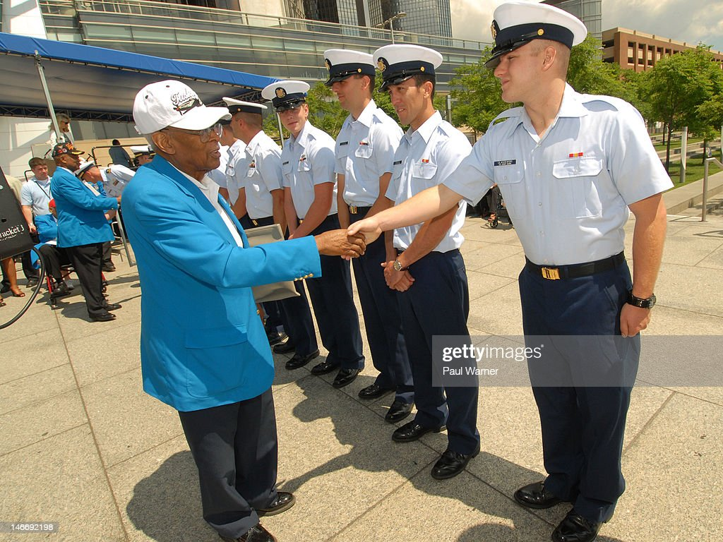 Tuskegee Airman Alexander Jefferson (L) greets servicemen at the opening ceremony and salute to the Airmen for the 2012 Detroit River Days Festival at the Detroit RiverWalk on June 22, 2012 in Detroit, Michigan.