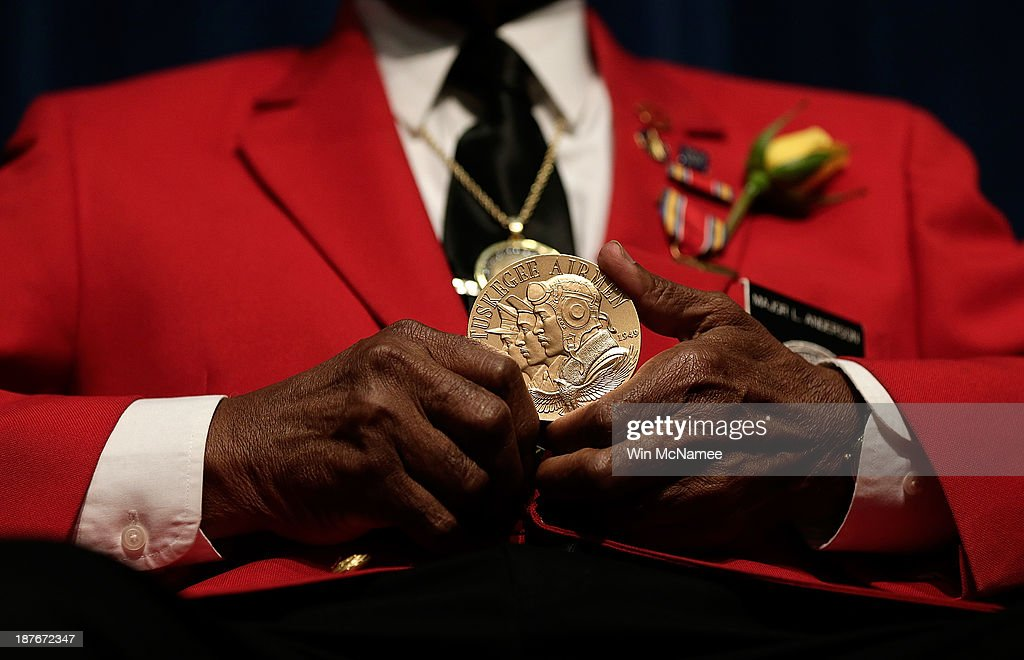 Tuskegee Airman Major Anderson shows off a Congressional Gold Medal given to all Tuskegee Airmen during a ceremony commemorating Veterans Day and honoring the group of World War II airmen November 11, 2013 in Washington, DC. The ceremony was held at the African American Civil War Museum on the day that World War I ended 95 years ago, the date the United States honors all of its military veterans.