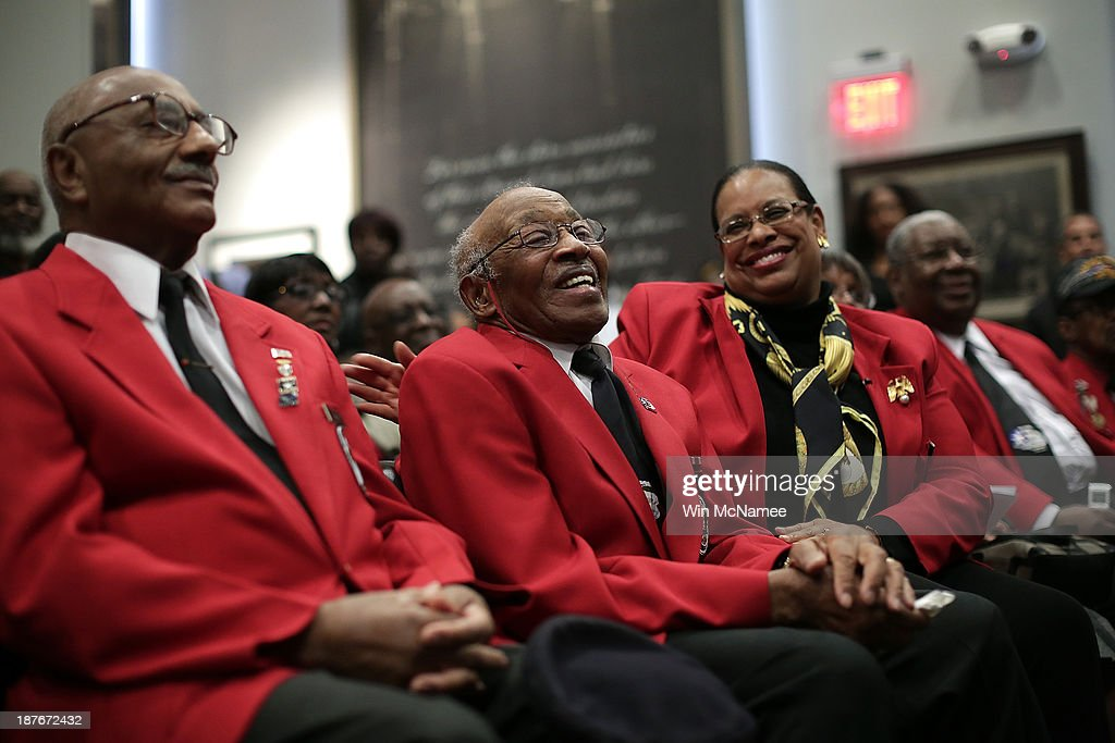 Tuskegee Airmen Ivan Ware (L) and Edward Talbert (2nd L) take part in a ceremony commemorating Veterans Day and honoring the Tuskegee Airmen November 11, 2013 in Washington, DC. The ceremony was held at the African American Civil War Memorial on the day that World War I ended 95 years ago, the date the United States honors all of its military veterans.