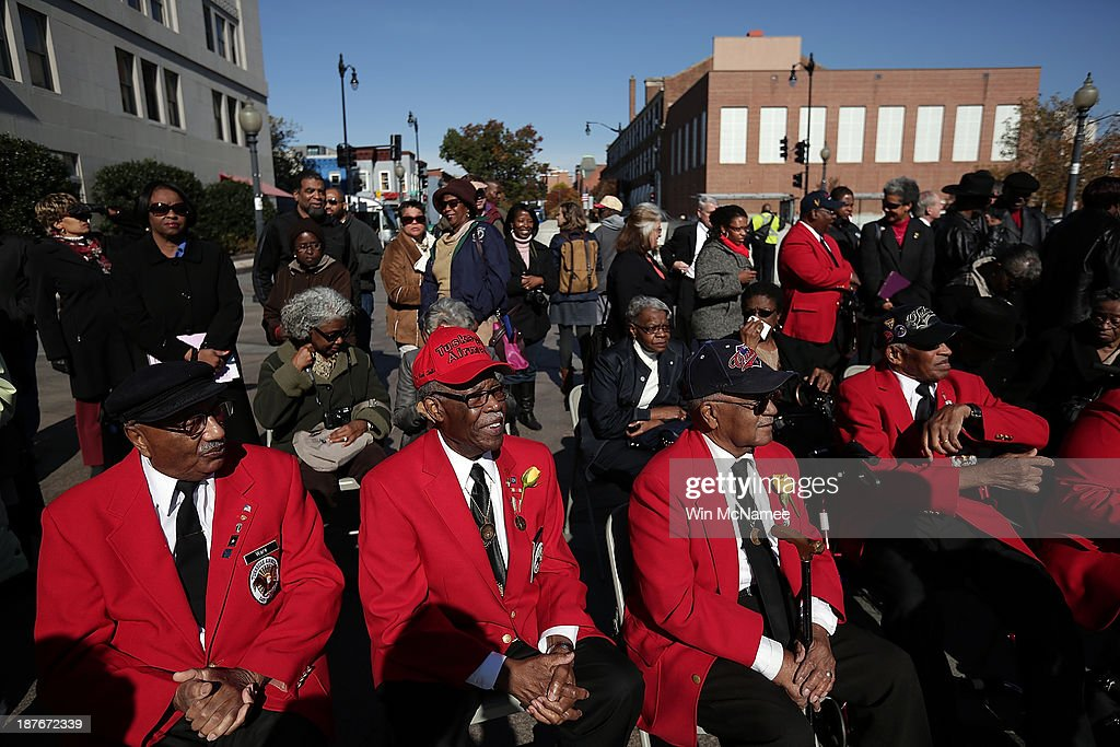 Tuskegee Airmen (L-R) Ivan Ware, Major Anderson, William Fauntroy, and Edward Talbert take part in a wreath-laying ceremony commemorating Veterans Day and honoring the Tuskegee Airmen November 11, 2013 in Washington, DC. The ceremony was held at the African American Civil War Memorial on the day that World War I ended 95 years ago, the date the United States honors all of its military veterans.