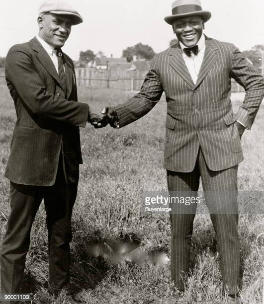 Tut Jackson and Jack Johnson shaking hands Competitors for the 'worlds colored heavy weight championship' meet in Ohio prior to their bout