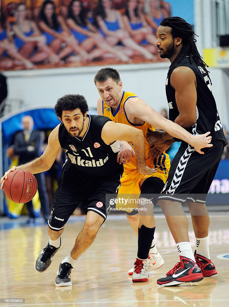 Tutku Acik, #11 of Besiktas JK Istanbul competes with Vitaly Fridzon, #7 of BC Khimki Moscow Region during the 2012-2013 Turkish Airlines Euroleague Top 16 Date 8 between BC Khimki Moscow Region v Besiktas JK Istanbul at Basketball Center of Moscow on February 22, 2013 in Moscow, Russia.