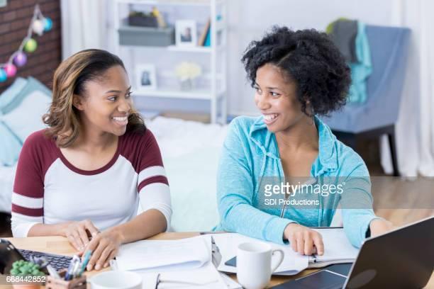 Tutor helps college girl with homework