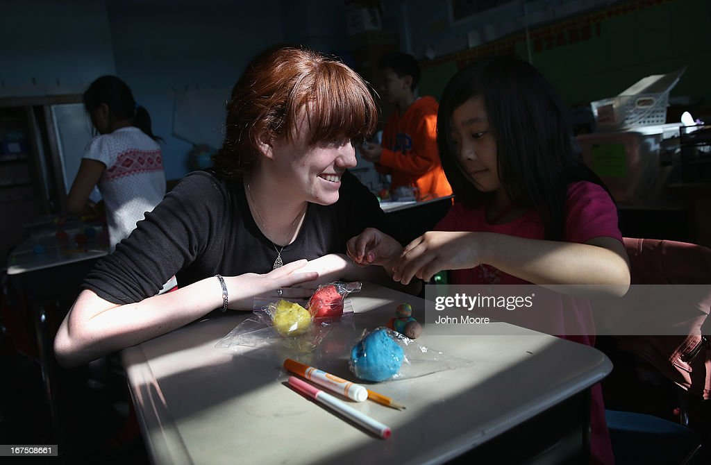 Tutor Tara McMahon works with a Tibetan child during an after-school program for asylum immigrants run by the International Rescue Committee (IRC), on April 25, 2013 in the Queens borough of New York City. The after-school program held at P.S. 199 consists of homework help and visual art instruction for Tibetan children in grades 2 through 4. The IRC is a non-profit humanitarian aid organization that aids refugees and survivors of international conflict. They assist new arrivals, many of whom come from refugee camps and war zones, to adjust to American society after being granted refugee status and invited by the U.S. government to live in the United States. The IRC also assists refugees through the immigration and naturalization process to become U.S. citizens.