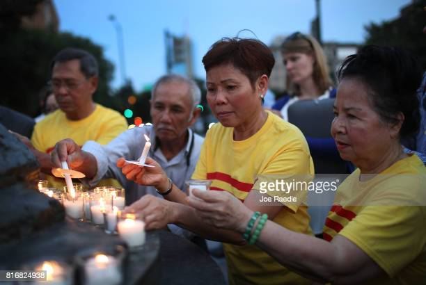Tuu Ngo and others attend a candlelight vigil in memory of Chinese Nobel Peace Prize laureate Liu Xiaobo on July 17 2017 in Washington DC Liu died of...
