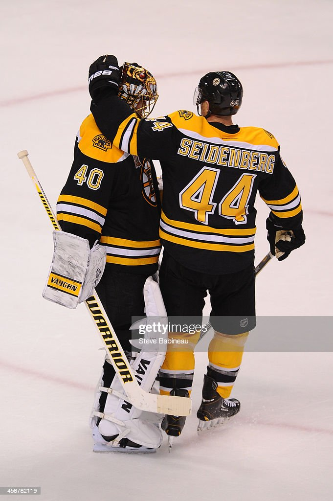 <a gi-track='captionPersonalityLinkClicked' href=/galleries/search?phrase=Tuukka+Rask&family=editorial&specificpeople=716723 ng-click='$event.stopPropagation()'>Tuukka Rask</a> #40 and <a gi-track='captionPersonalityLinkClicked' href=/galleries/search?phrase=Dennis+Seidenberg&family=editorial&specificpeople=204616 ng-click='$event.stopPropagation()'>Dennis Seidenberg</a> #44 of the Boston Bruins celebrate a win against the Buffalo Sabres at the TD Garden on December 21, 2013 in Boston, Massachusetts.