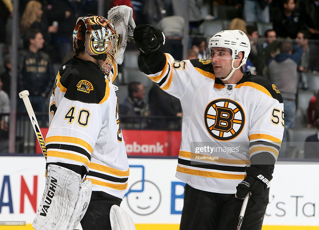 Tuukka Rask #40 and Johnny Boychuk #55 of the Boston Bruins celebrate the win against the Toronto Maple Leafs during NHL action at the Air Canada Centre February 2, 2013 in Toronto, Ontario, Canada.