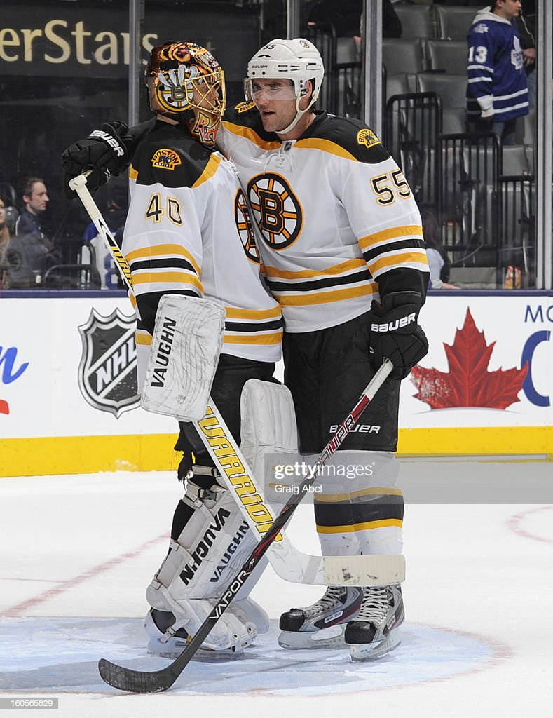 <a gi-track='captionPersonalityLinkClicked' href=/galleries/search?phrase=Tuukka+Rask&family=editorial&specificpeople=716723 ng-click='$event.stopPropagation()'>Tuukka Rask</a> #40 and <a gi-track='captionPersonalityLinkClicked' href=/galleries/search?phrase=Johnny+Boychuk&family=editorial&specificpeople=2125695 ng-click='$event.stopPropagation()'>Johnny Boychuk</a> #55 of the Boston Bruins celebrate the win over the Toronto Maple Leafs during NHL game action February 2, 2013 at the Air Canada Centre in Toronto, Ontario, Canada.