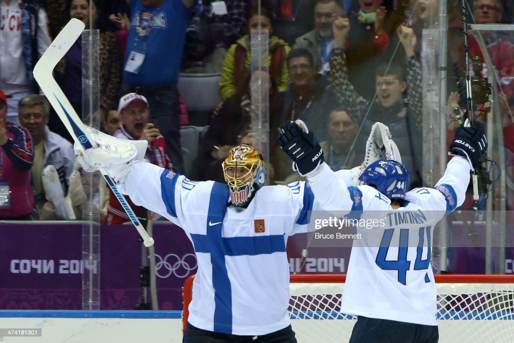 Tuukka Rask #40 and Kimmo Timonen #44 of Finland celebrate after defeating the United States 5-0 during the Men's Ice Hockey Bronze Medal Game on Day 15 of the 2014 Sochi Winter Olympics at Bolshoy Ice Dome on February 22, 2014 in Sochi, Russia.