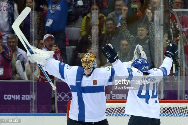 Tuukka Rask and Kimmo Timonen of Finland celebrate after defeating the United States 50 during the Men's Ice Hockey Bronze Medal Game on Day 15 of...