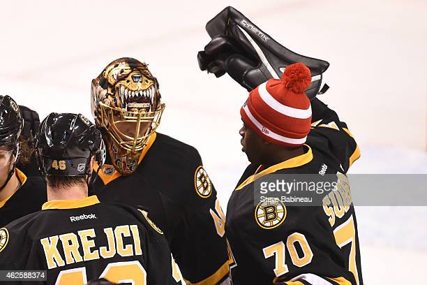 Tuukka Rask and Malcolm Subban of the Boston Bruins celebrate the game win against the Los Angeles Kings at the TD Garden on January 31 2015 in...