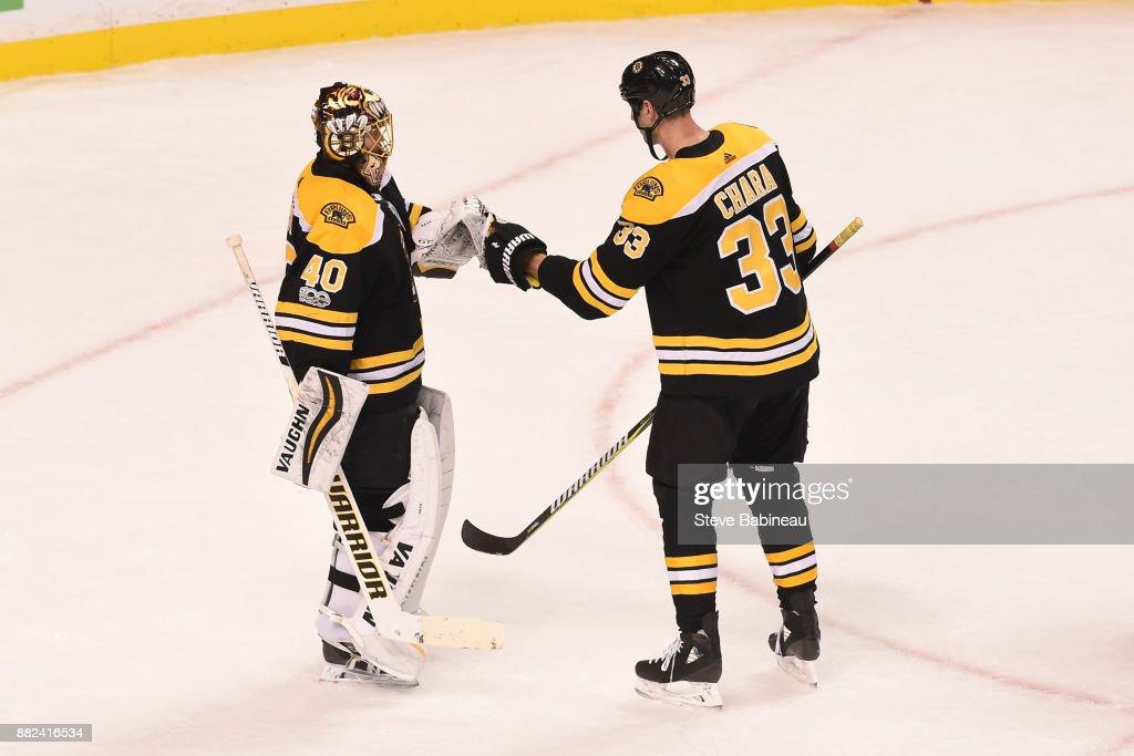 Tuukka Rask #40 and Zdeno Chara #33 of the Boston Bruins celebrate a win against the Tampa Bay Lightning at the TD Garden on November 29, 2017 in Boston, Massachusetts.