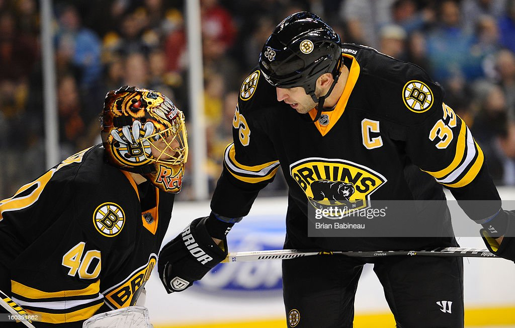 Tuukka Rask #40 and Zdeno Chara #33 of the Boston Bruins chat during a time out against the New Jersey Devils at the TD Garden on January 29, 2013 in Boston, Massachusetts.